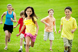 Children running outdoors.