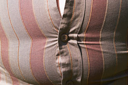 Too-tight shirt stretched across bulging stomach.
