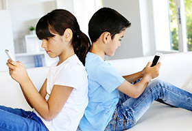 Girl and boy using smartphones