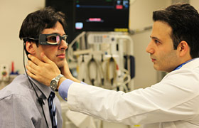 Patient wears a goggle that measures tiny eye movements.