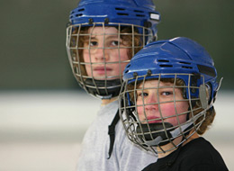 Boys wearing hockey masks