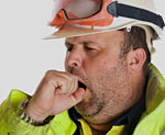 Construction worker yawning.